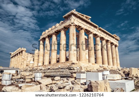 Parthenon on the Acropolis in Athens, Greece. Famous old Parthenon temple is the main landmark of Athens. Ancient Greek ruins in the Athens center in summer. Majestic remains of antique Athens.