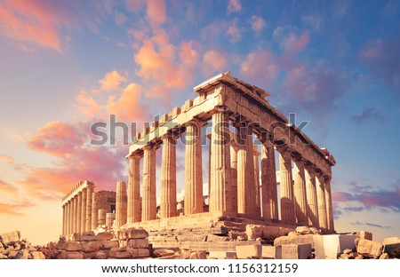 Parthenon temple on a sunset with pink and purple clouds. Acropolis in Athens, Greece