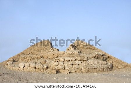 Partial excavated burial mound exposing the limestone blocks