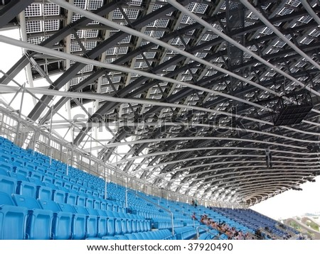 Partial view of a large sports venue with few people