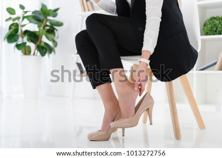 partial view of businesswoman sitting at workplace in office #1013272756