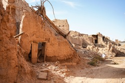 Partially destroyed and collapsed mud houses in Shaqra traditional village, Saudi Arabia