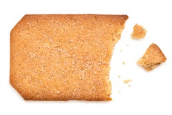 Partially eaten rectangular sugar coated cinnamon biscuit isolated on white. Top view.