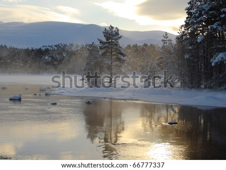 Partially frozen lake. (Loch Morlich, Scotland, which is situated in the Cairngorm National Park.)