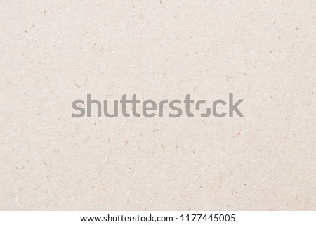 Particleboard, chipboard background with grainy texture of particle presses wooden panel or OSB Oriented strand board in beige light brown cream sepia color