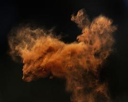 Particles cloud against dark background