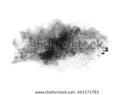 Photo of  particles of charcoal on white background,abstract powder splatted on white background,Freeze motion of black powder exploding.