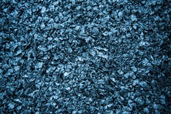 Particles of crushed plastic are black in color. Plastic before melting. Reuse. The concept of caring for the environment.