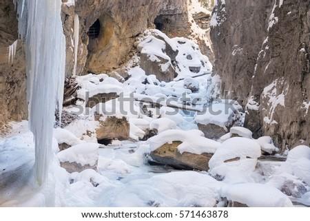 Partnachklamm (Partnach Gorge) with snow-covered rocks and icicles in winter, Garmisch-Partenkirchen, Bavaria, Germany #571463878