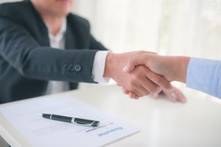 Partner Business  signing contractpaper  for partnership and law,  Business owners shake hands to agree to work.Partners hold hands to accept work.Businessman feedback document concept