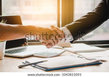 Partners corporate relationship concept. Close up handshake of business people in meeting attendance.