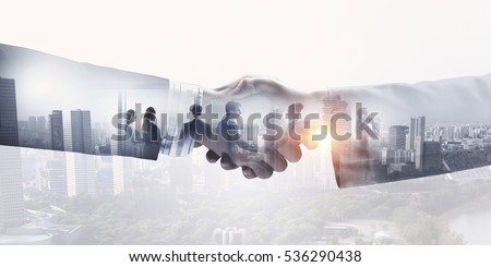 Partners shaking hands . Mixed media #536290438