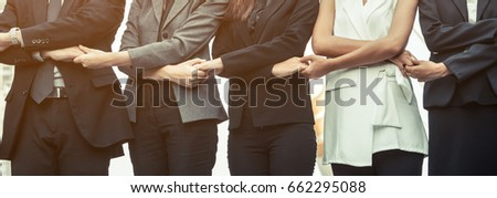 Partnership and togetherness concept. - Business people holding hands together showing teamwork for success.