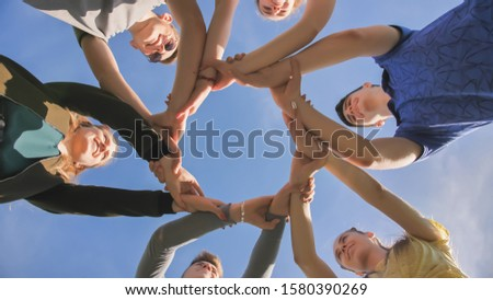 Partnership and unity concept: people holding wrists of each other #1580390269