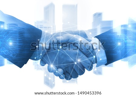 Partnership - business man shaking hands with effect digital network link connection graphic diagram, digital global technology with cityscape background, internet communication and teamwork concept