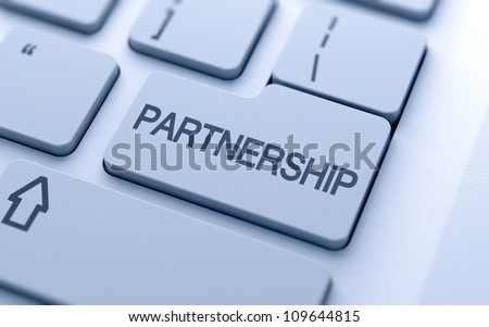 Partnership button on keyboard with soft focus
