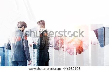 Partnership concept with businesspeople discussing and shaking hands on Singapore city background. Double exposure
