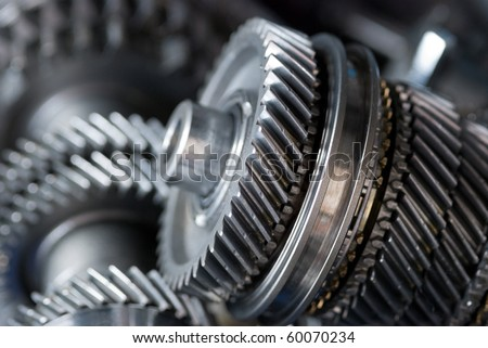 Parts from a vehicle gearbox. Shallow depth of field with the nearest gear in focus.