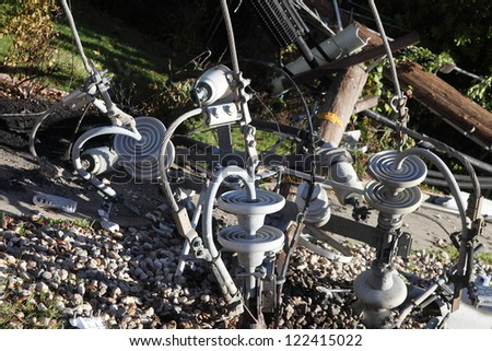 parts of a power pole on the ground after an auto accident