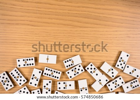 parts of game of domino on wood ...