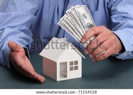 parts of hands with house and money