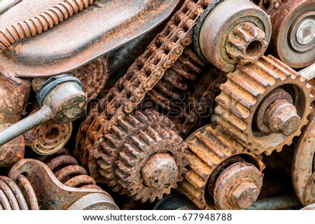 parts of old broken machine under corrosion closeup