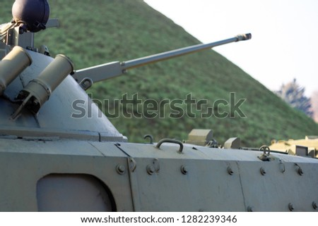 Parts of the hull of the armored infantry vehicle. In front and back of vehicle stays many different armored military vehicles. Military equipment outdoor open air museum. #1282239346