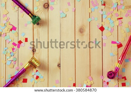 party background with colorful confetti and party whistle