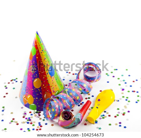 party background with serpentines confetti and hat