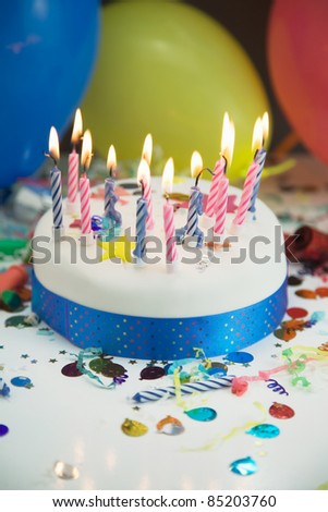 Party Concept Showing A Birthday Cake,Candles,Balloons And Party