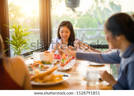 Party Concept. Young people enjoying harvest time together at cafe and restaurant.