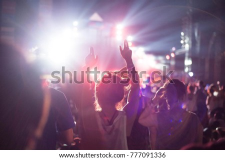 party concert,night party concert,people dancing in concert party,christmas concert party,blur and Flair image,selective focus