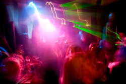 Party. Dancing people. A party in a nightclub. Laser illumination.