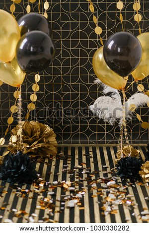 Party decor. Golden decoration on black background with ballons #1030330282