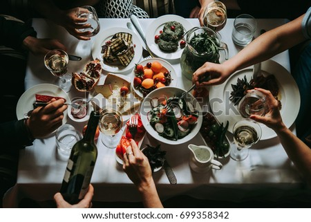 Party dinner table, celebrating with friends of family served at home or in a restaurant. Toned picture