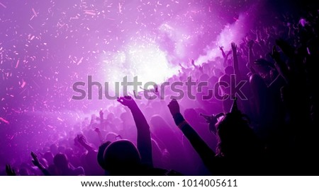 Party goers in a nightclub with co2 cannons firing #1014005611