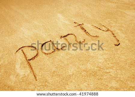 Party handwritten in sand on a beach #41974888