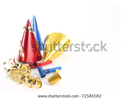 Party hats, blower and streamers isolated on white
