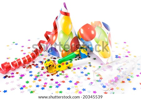 Party hats, horns or whistles and confettis on white background.