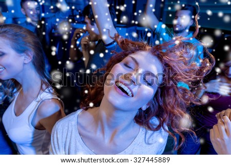 party, holidays, celebration, nightlife and people concept - smiling friends dancing in club #327445889