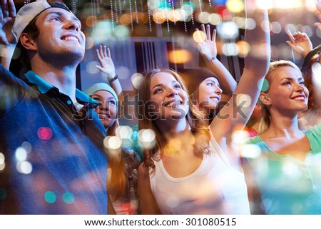 party, holidays, music events, nightlife and people concept - group of happy friends at hip-hop concert in night club Stock photo ©