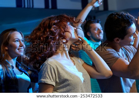 party, holidays, nightlife and people concept - happy friends dancing at night club Stock photo ©