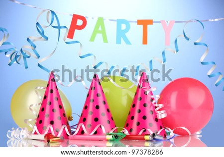 Party items on blue background - stock photo