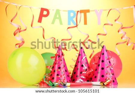 Party items on orange background - stock photo