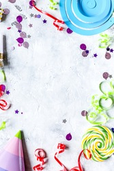 party set with hat, lollipop and confetti stone background top view mock-up