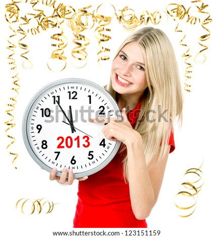 party time new year 2013. five to twelve. young beautiful woman with big clock and party decoration