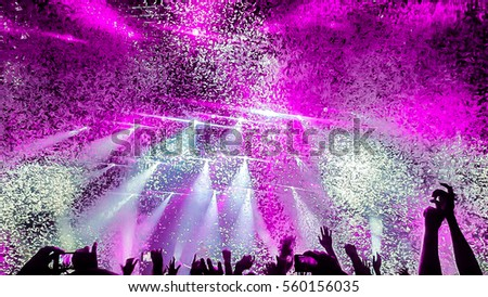 Party with confetti and laser rays #560156035