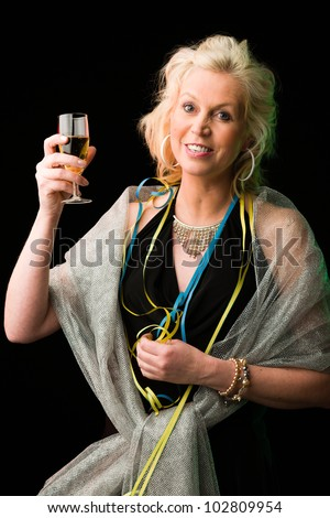 Partying woman in party with a alcoholic beverage, black background - stock photo