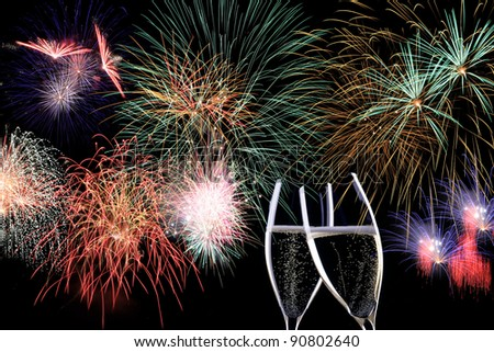Partytime with  Fireworks and two glasses of Champaign