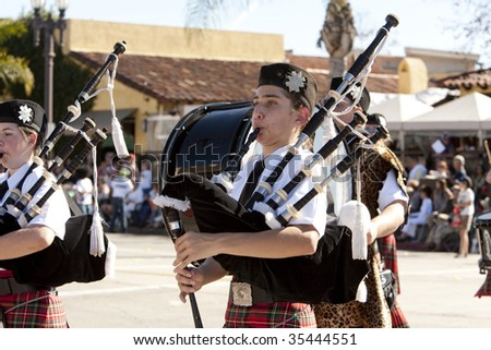 PASADENA, CA - JANUARY 18:  The drum major leads his kilted band at the Doo Dah Parade on January 18, 2009 in Pasadena, CA.  This parade is a parody of Pasadena's more famous Rose Parade.